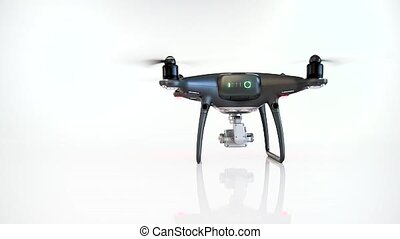 Black drone with camera landing on a white background. ...