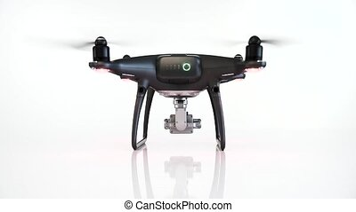 Black drone with camera takes off on white background. ...
