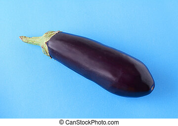 Black eggplant on a light blue background
