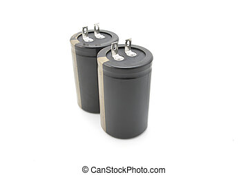 Two black electrolytic capacitor for flash isolated on white