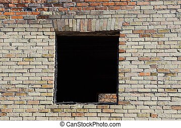 black empty window on old brown brick wall
