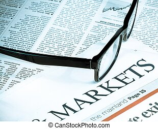 black eye glasses near word markets, business and finance concept
