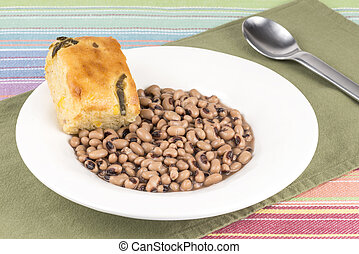 Black eye peas and corn bread - A bowl of black eye peas and...