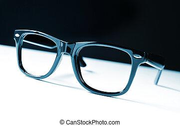 black eyeglasses - a pair of black plastic-rimmed eyeglasses...