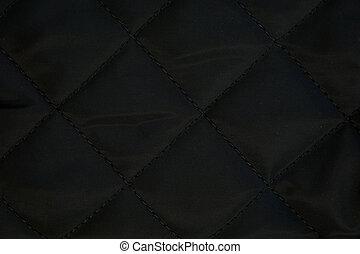 black fabric background, pattern.