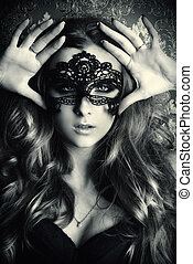 black face mask - Beautiful young woman with long wavy hair...
