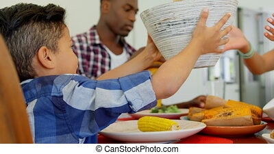 Black family having food on dining table at home 4k