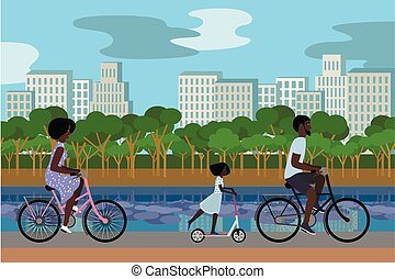 Black family in the park riding bicycles