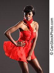 Black fashion model in red dress