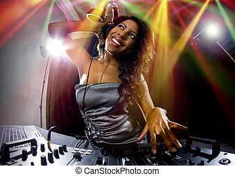 Black Female DJ - young african american female dj playing...