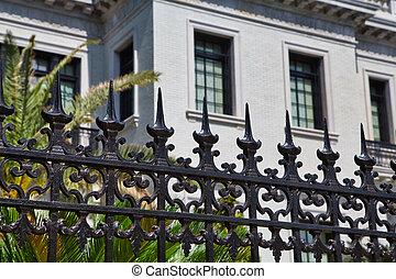 Black Fence on White Home