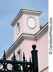 Black Fence Pink Building