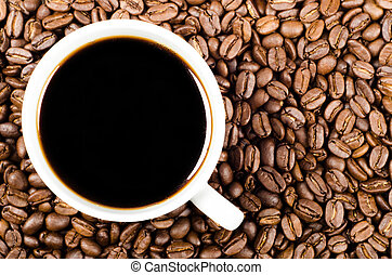 black filter coffee on coffee beans with copy space - black...