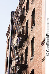Black Fire Escape on Old Red Brick Building
