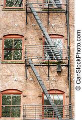 Black Fire Escape on Red Brick Building
