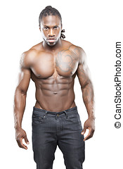 Black fitness model in jeans with no shirt flexing muscles