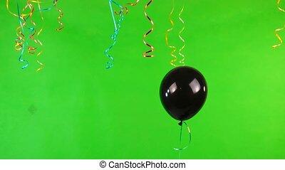 black flying balloon on green screen