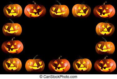 black frame made of carved halloween pumpkins