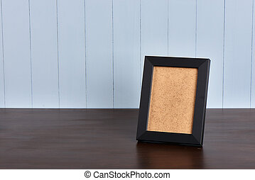 black frame on a wooden table