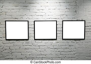 black frames on white brick wall 2