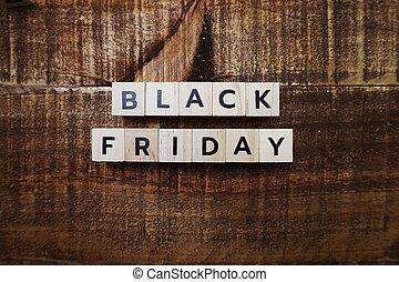 Black Friday alphabet letter on wooden background