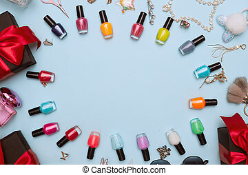 black friday concept, manicure with nail polish, pedicure on blue background, copy space, flat lay