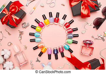 black friday concept, manicure with nail polish, pedicure on pink background, copy space, flat lay