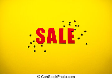 Black friday concept. Sale in red letters on a yellow background with confetti