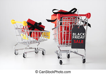 Black friday label with red gift box in shopping cart