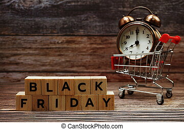 Black Friday message alphabet letter on wooden background