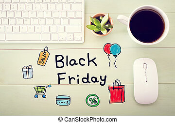 Black Friday message with workstation on a light green...
