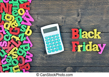 Black friday on wooden table