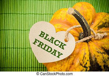 Black Friday price tag on a pumpkin.