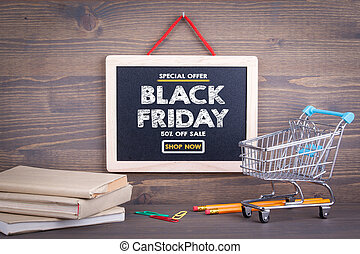 Black Friday sale. Chalkboard on a wooden background