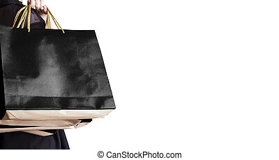 Black friday sale concept of young woman holding shopping bag isolated on white background with copy space