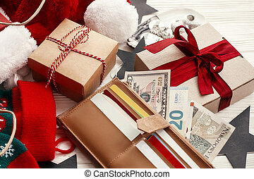 Black Friday sale. Credit cards and money in wallet, paper bags with clothes, stockings, gift boxes, jewelry on white rustic background. Christmas shopping and seasonal sale
