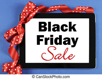 Black Friday Sale message on black computer tablet device with red ribbon on blue background.