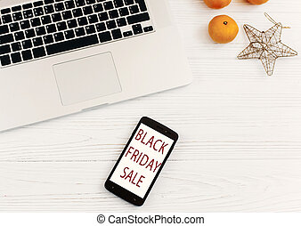 black friday sale. special offer discount text on mobile phone screen on seasonal rustic background