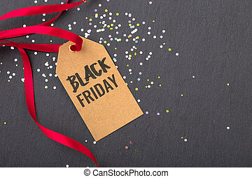 Black friday sale tag with red ribbon