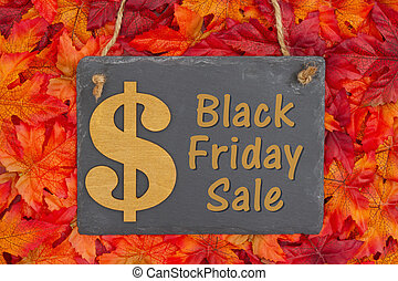 Black Friday Sale with a chalkboard with a gold dollar sign and fall leaves