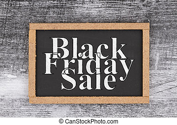 Black Friday Sale word message on grunge chalkboard sign with wood frame