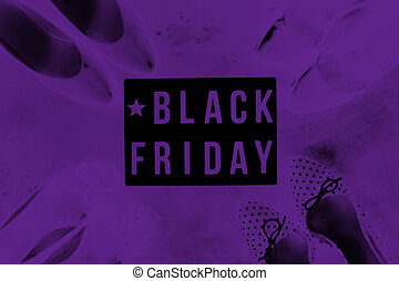 Black friday sale word on lightbox on dark table top view