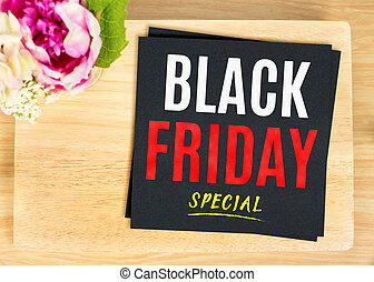 Black Friday special word on black paper on wood table top view, Banner for advertising promotion sale
