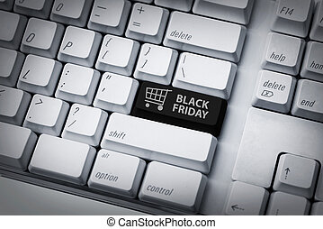 Black friday text and shopping cart on keyboard