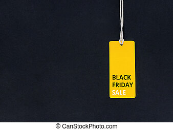 Black friday. Yellow Sale tag on the black background