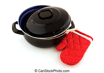 Black frying pan with kitchen glove and wooden spoon