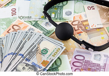 Black gag and heap of american dollars on euro banknotes