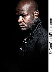 """Black \""""gangster men\"""" looking serious on a dark background"""