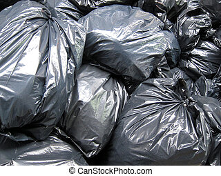 black garbage bags stacked on each other