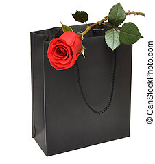 black gift bag with red rose